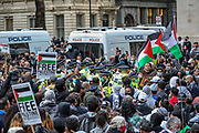 """London, United Kingdom, May 11, 2021: British Police try to maintain order outside Downing Street during a """"Save Sheikh Jarrah"""" pro-Palestinian demonstration in central London on Tuesday, May 11, 2021. At least 24 Palestinians were killed last night in Israeli air raids on the besieged Gaza Strip. (Photo by Vudi Xhymshiti/VXP)"""