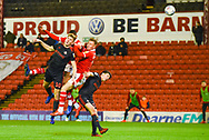 Jimmy Dunne of Sunderland (30) wins a header in a group of players during the EFL Sky Bet League 1 match between Barnsley and Sunderland at Oakwell, Barnsley, England on 12 March 2019.
