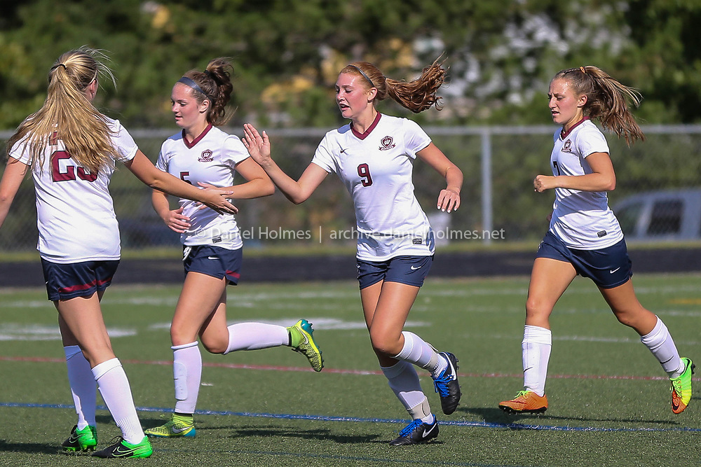 (9/7/17, WESTBOROUGH, MA) Westborough's Skyler Barry (9) gets a high-five after scoring during the girls soccer game against Nipmuc at Westborough High School on Thursday. [Daily News and Wicked Local Photo/Dan Holmes]