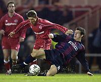 Photo. Jed Wee<br />Middlesbrough v Bradford Reserves, The Riverside, Middlesbrough. 25/02/2003.<br />Bradford's Craig Bentham (R) slids in to try to dispossess Middlesbrough's Juninho.