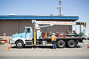 A 14-foot in-line inspection tool, also called Smart Pig, is loaded onto a Pacific Gas and Electric Company (PG&E) truck for transportation from the Milpitas Gas Terminal to Fremont after the media presentation on July 9, 2012.  The Smart Pig will allow PG&E to survey the interior and exterior condition of local underground gas pipelines.  Photo by Stan Olszewski/SOSKIphoto.