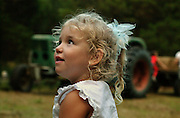 A young girl on a farm.