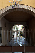 """Luino, Lombardia. ITALY.   """"Luino Old Town"""". Arch entrance to court yard,  located in the  steep hilly narrow streets, on the side of Lake Maggiore, Province of Varese.. ITALY <br /> <br /> <br /> Monday  02/01/2017   <br /> <br /> © Peter SPURRIER,<br /> <br /> <br /> LEICA CAMERA AG LEICA Q (Typ 116). ISO 100  f1.7  28mm"""