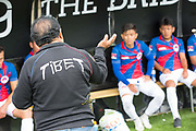 Tibetan coach giving some advice during half time. London Turkish All-Stars Vs Tibet during the Conifa Paddy Power World Football Cup Placement Match A on the 5th June 2018 at Bromley in the United Kingdom. London Turkish All-Stars 4 Tibet 0. Tibet were due to play Ellan Vannin, although Ellan Vannin were withdrawn by CONIFA. Ellan Vannin's withdrawal comes following a vote of the tournament management committee on Monday 4 June, which rejected a challenge by Ellan Vannin to the eligibility of a Barawa player. The CONIFA World Football Cup is an international football tournament organised by CONIFA, an umbrella association for states, minorities, stateless peoples and regions unaffiliated with FIFA.