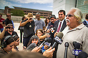21 AUGUST 2012 - PHOENIX, AZ: SALVADOR REZA, a Phoenix civil rights activists, talks about racial profiling by Phoenix law enforcement during a press conference about the enforcement of SB 1070 in Phoenx. A handful of protesters waited outside the Sandra Day O'Connor Courthouse in Phoenix Wednesday while lawyers from the American Civil Liberties Union (ACLU) and Mexican American Legal Defense and Education Fund (MALDEF) sparred with lawyers from Maricopa County and the State of Arizona over the constitutionality of section 2B of SB 1070, Arizona's tough anti-immigrant law. Most of the law was struck down by the US Supreme Court in June, but the Justices let section 2B stand pending further review. The suit is being heard in District  Judge Susan Bolton's court. It was Judge Bolton who originally struck down SB 1070 in 2010. A ruling is expected later in the year.   PHOTO BY JACK KURTZ