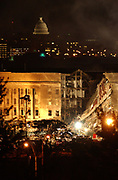 Arlington, Virginia (Sept. 11, 2001) -– Smoke and flames rose over the Pentagon late into the night, following a suspected terrorist crash of a commercial airliner into the southwest corner of the Pentagon. Part of the building has collapsed meanwhile firefighters continue to battle the flames and look for survivors. An exact number of casualties is unknown. The building was evacuated, as were the federal buildings in the Capitol area, including the White House. U.S. Navy Photo