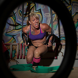 Rhonda fights for her ring dips at the Winter WOD Fest CrossFit competition. Crossfit image, picture, photo, photography of health, elite, exercise, training, workouts, WODs, taken at Progressive Fitness CrossFit,Colorado Springs, Colorado, USA
