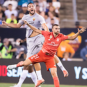 MEADOWLANDS, NEW JERSEY- August 7: Borja Mayoral #21 of Real Madrid challenged by  Kostas Manolas #44 of AS Roma during the Real Madrid vs AS Roma International Champions Cup match at MetLife Stadium on August 7, 2018 in Meadowlands, New Jersey. (Photo by Tim Clayton/Corbis via Getty Images)