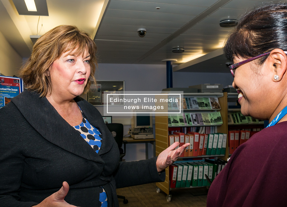 Pictured: Scottish Government Public Libraries Funding Announcement. Culture Minister Fiona Hyslop announces this year's successful bids to the £450,000 Public Library Improvement Fund (PLIF) at the John Grey Centre, Haddington Library, Haddington, East Lothian, Scotland, United Kingdom.  PLIF has been supporting innovative library projects since 2006 which help both individuals and communities. Fiona Hyslop meets Dr Hanita Ritchie, Local History Officer and organiser of Haddington Film Appreciation Club. 13 December 2018  <br /> <br /> Sally Anderson   EdinburghElitemedia.co.uk