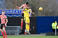 Sunderland defender Jack Baldwin (15) beats Oxford United forward Jerome Sinclair (9) to the ball during the EFL Sky Bet League 1 match between Oxford United and Sunderland at the Kassam Stadium, Oxford, England on 9 February 2019.