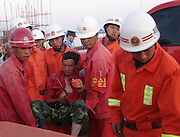 KARAMAY, CHINA - AUGUST 01: (CHINA OUT) <br /> <br /> Man Survives After Steel Bar Pierces Through Body<br /> <br /> A firefighter cuts a steel bar, which pierces through a labor's body, at a hospital on August 1, 2013 in Karamay, Xinjiang Uygur Autonomous Region of China. The man survived after a scaffold he was standing on collapsed at a construction site on Wednesday. He landed right on top of a 2cm in-diameter steel bar that pierced his body. <br /> ©Exclusivepix