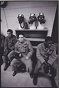 Draftees in Basic Training at Ft. Dix, NJ in 1972. Soldiers sit through a lecture on Chemical, Biological, and Radiological (CBR) training prior to a test in a tear gas filled environment with gas masks.