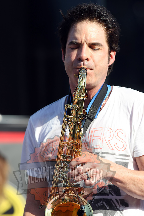 Pat Monahan of the Grammy award winning band Train plays the saxophone  during a one hour performance prior to the start of the NASCAR Coke Zero 400 race at Daytona International Speedway in Daytona Beach, Fl., on Saturday July 7, 2012. (AP Photo/Alex Menendez) Grammy Award winning band TRAIN plays an hour long concert prior to the NASCAR Coke Zero 400 race at Daytona International Speedway in Daytona Beach, Florida on July 7, 2012.