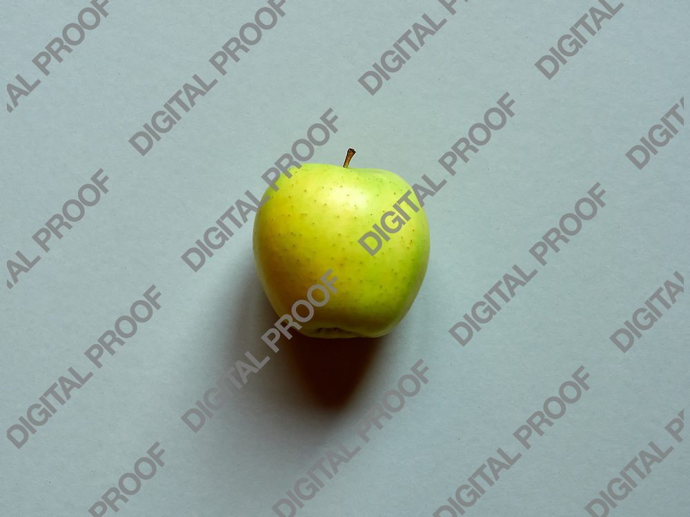 Above view of a Green apple isolated in a grey background in studio