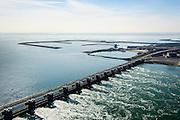 Nederland, Zeeland, Gemeente Schouwen-Duiveland, 01-04-2016; stormvloedkering Oosterschelde (Oosterscheldekering) gezien naar Neeltje Jans. Het is eb en het water stroomt van de Oosterschelde naar de Noordzee door het sluitgat Schaar.<br /> Eastern Scheldt storm surge barrier (Oosterscheldekering). It is low tide and the water flows from the Eastern Scheldt to the North Sea.<br /> <br /> luchtfoto (toeslag op standard tarieven);<br /> aerial photo (additional fee required);<br /> copyright foto/photo Siebe Swart
