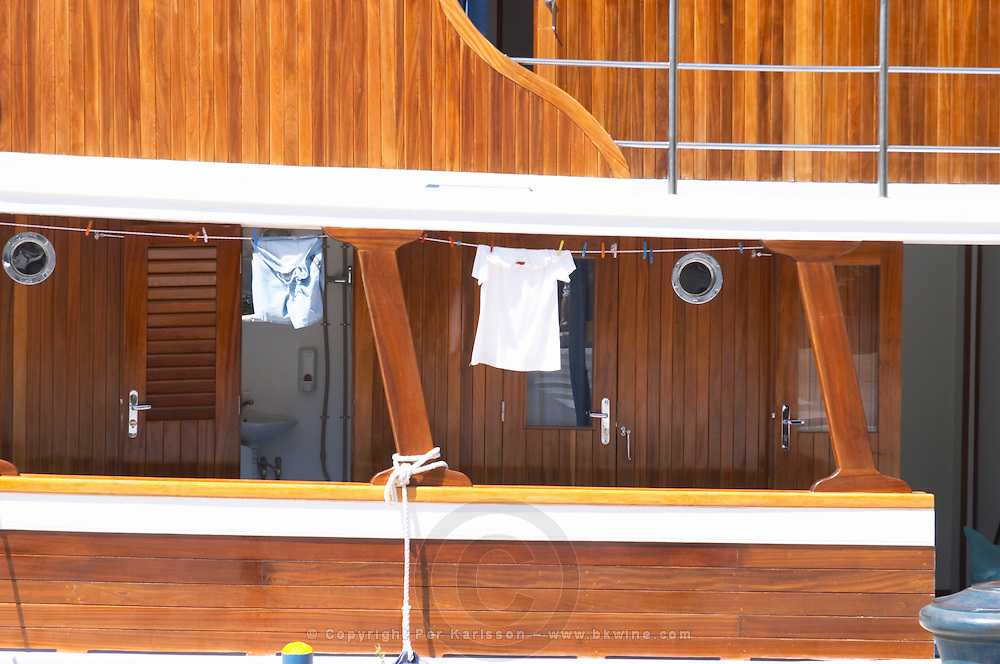Detail of a beautiful wooden cruise boat ship with washing hanging to dry. Wood panelled. Luka Gruz harbour. Dubrovnik, new city. Dalmatian Coast, Croatia, Europe.