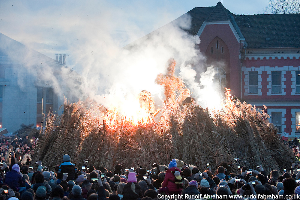 Busó carnival, Mohács, Hungary. Following a procession through town by the busós on the last Sunday before Lent, a huge bonfire with an effigy on top is lit on the town square. The Busó carnival or Busójárás is inscribed on the Unesco list of Intangible Cultural Heritage. © Rudolf Abraham