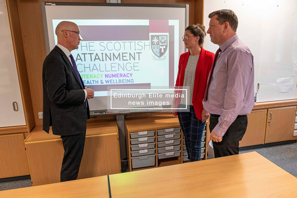 Pictured: John Swinney discussed the attainment programme with Robyn Wade, PEF co-ordinator, and Andy Rooney, Schools Programme Co-ordinator<br /><br />The Deputy First Minister visited Holy Rood High School in Edinburgh today to meet parents and pupils before announcing GBP50 million funding for improving attainment.  The results of a survey of headteachers were also published during the Deputy First Minister's visit.<br /><br /> Ger Harley   EEm 30 May 2019