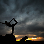 Jade Rosenkranz in yoga pose at sunset in the desert near Page, Arizona during spring cloud cover.