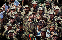 """KABUL,AFGHANISTAN - SEPT. 9: An Afghan police officer chants """"Allah Akbar"""" or """"God is Great"""" during a ceremony in Kabul Sports Stadium September 9, 2002  to comemerate the anniversary of the death of Ahmad Shah Massoud in Kabul, Afghanistan. (Photo by Ami Vitale/Getty Images)"""