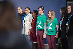 9 December 2019, Madrid, Spain: Dressed in green t-shirts reading 'Creation - Not for Sale', Lutheran World Federation delegates Erika Rodning from Canada (right) and Erik Bohm from Sweden (left) join Fridays for Future, as they create a 'human chain', demanding climate justice and urgent action from politicians at COP25 in Madrid.