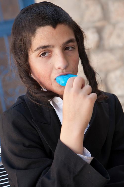 Middle East, Zafed, Hasidic Jewish boy eating popsicle