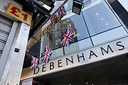 People pass Debenhams flagship department store on Oxford Street as it is announced that talks to save the company have failed on 1st December 2020 in London, United Kingdom. Debenhams has been an ever present feature all over the UK for 242 years, but it has been announced that it will close all of its shops at the cost of around 12,000 jobs, and go into liquidation. This huge blow to the high street has not come as a surprise as the company has been struggling for some time.