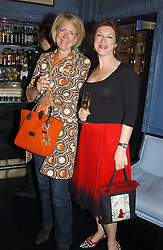 Left to right, MARIE CLAIRE AGNEW and MARDI GILMOUR at a fashion show with designs by Irish designer Louise Kennedy held in the Blue Bar, Berkeley Hotel, London on 12th May 2005.<br /><br />NON EXCLUSIVE - WORLD RIGHTS