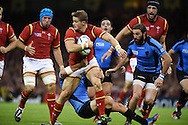Hallam Amos of Wales is stopped. Rugby World Cup 2015 pool A match, Wales v Uruguay at the Millennium Stadium in Cardiff, South Wales  on Sunday 20th September 2015.<br /> pic by  Andrew Orchard, Andrew Orchard sports photography.