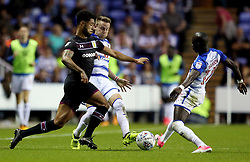 Aston Villa's Andre Green (left) is tackled by Reading's Chris Gunter (centre) during the Sky Bet Championship match at the Madjeski Stadium, Reading.