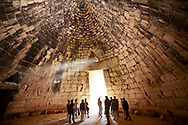 """Interior of the Treasury of Atreus is an impressive """"tholos"""" beehive shaped tomb on the Panagitsa Hill at Mycenae Archaeological site . <br /> <br /> Visit our MYCENAEN ART PHOTO COLLECTIONS for more photos to download  as wall art prints https://funkystock.photoshelter.com/gallery-collection/Pictures-Images-of-Ancient-Mycenaean-Art-Artefacts-Archaeology-Sites/C0000xRC5WLQcbhQ<br /> .<br /> <br /> Visit our GREEK HISTORIC PLACES PHOTO COLLECTIONS for more photos to download or buy as wall art prints https://funkystock.photoshelter.com/gallery-collection/Pictures-Images-of-Greece-Photos-of-Greek-Historic-Landmark-Sites/C0000w6e8OkknEb8"""