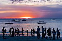 people enjoying on the beach at Sunset  n Unguja aka Zanzibar Island Tanzania East Africa