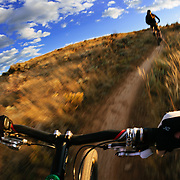 Jay Goodrich chases Brennen Fitzgerald on the Boneyard Trail in Eagle, Colorado at Sunset.