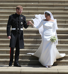 Meghan Markle and Prince Harry leave St George's Chapel at Windsor Castle following their wedding.