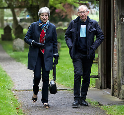 Prime Minister Theresa May and her husband Philip leave following a church service near her Maidenhead constituency.