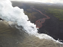 Handout photo taken on May 21, 2018 of KÄ«lauea Volcano — Ocean Entry. By the end of the afternoon, only a single ocean entry was active. The lava channel originates from fissure 22. This photo was taken during a late afternoon overflight of the lower East Rift Zone, KÄ«lauea Volcano. Photo by usgs via ABACAPRESS.COM