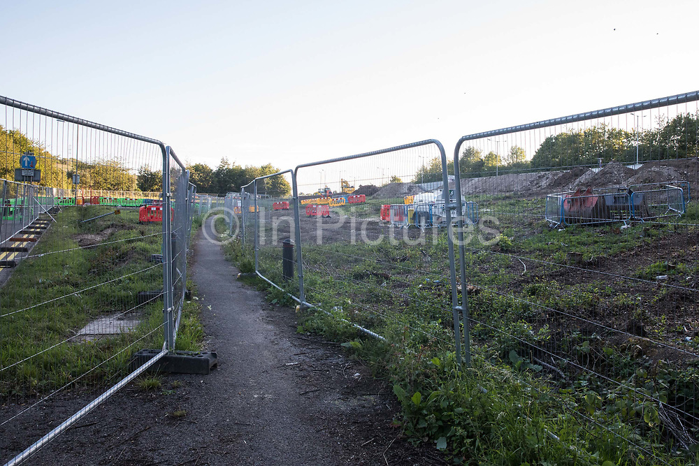 Fencing is positioned around land cleared of trees and undergrowth at the HS2 Buckinghamshire Junctions Laydown Area on 17th July 2020 in Amersham, United Kingdom. The Department for Transport approved the issuing of Notices to Proceed by HS2 Ltd to the four Main Works Civils Contractors MWCC working on the £106bn high-speed rail link project in April 2020.