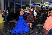 Teacher Dawn Foley, the prom sponsor, awards the Junior Prom Princess, Maya Maupin as Fairdale High School holds it's prom at the Muhammad Ali Center on Saturday, May 18.