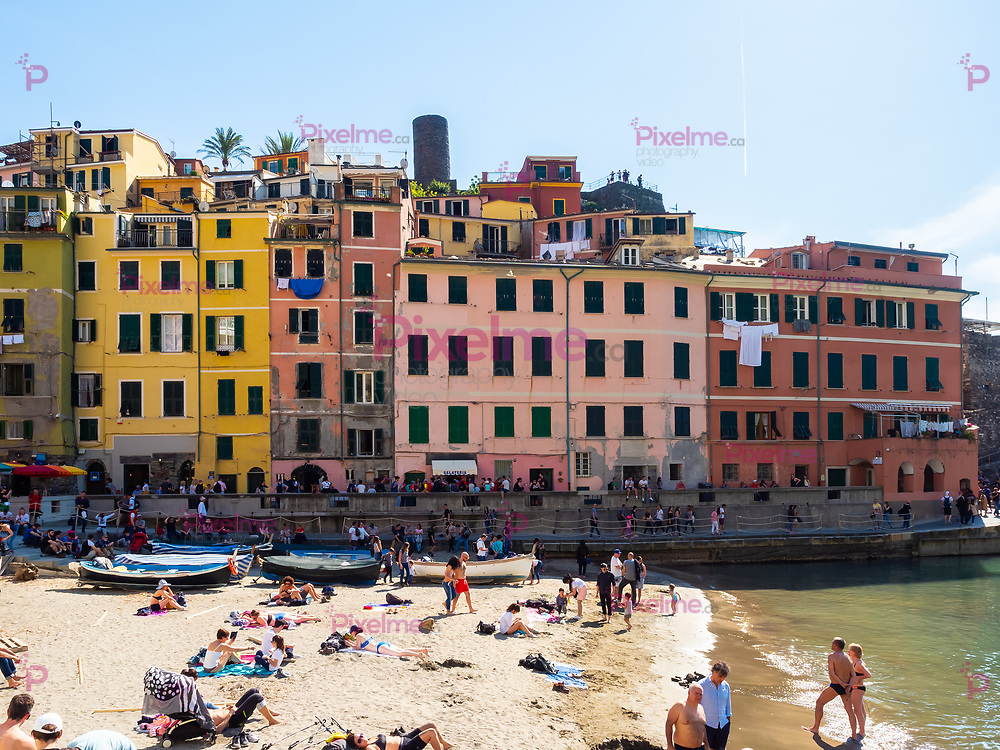 Vernazza, Italy - April 20, 2019 Buildings standing at the port of  Vernazza town in Cinque Terre Region - Italy