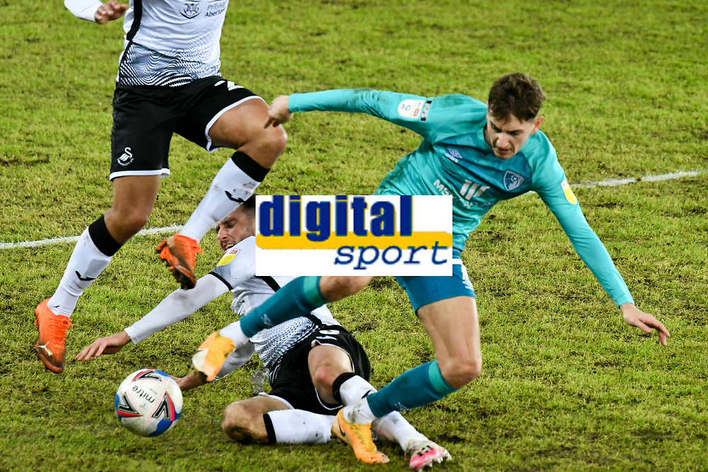 Football - 2020 / 2021 Sky Bet Championship - Swansea City vs AFC Bournemouth - Liberty Stadium<br /> <br /> <br /> David Brooks of Bournemouth tackled by Matt Grimes in a stadium without fans because of the pandemic crisis<br /> <br /> COLORSPORT/WINSTON BYNORTH