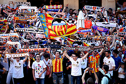 Valencia fans hold up scarves, flags and banners as they make their way to the stadium ahead of the UEFA Europa League, Semi Final, Second Leg at the Camp de Mestalla, Valencia.