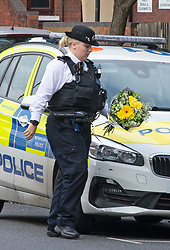 ©Licensed to London News Pictures 01/10/2020  <br /> Croydon, UK. A police officer with flowers.  Metropolitan Police Commissioner Cressida Dick was at Croydon Custody Centre this morning for a visit. The murder investigation continues at pace after the death of police sergeant Matt Ratana almost a week ago at the Croydon Custody Centre in South London. Photo credit:Grant Falvey/LNP
