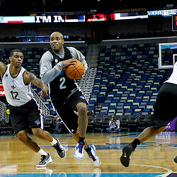 December 17, 2011; New Orleans, LA, USA; New Orleans Hornets black team point guard Jarrett Jack (2) drives past New Orleans Hornets white team shooting guard Trey Johnson (12) during a scrimmage at the New Orleans Arena.   Mandatory Credit: Derick E. Hingle-US PRESSWIRE