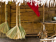 A roadside stall selling brooms made from kok kham, a type of wild grass by Prai ethnic minority women in Sayaboury province, Lao PDR.