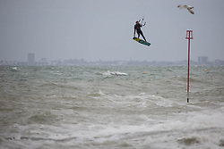 © Licensed to London News Pictures.  03/05/2021. Brighton, UK. The kitesurfer catches the wind along cost line of Brighton Beach in East Sussex, following The May Day, bank holiday as forecasts predict strong winds and rain for the coming week. Photo credit: Marcin Nowak/LNP
