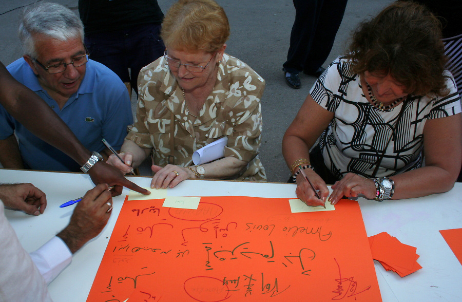 Miguel (Aragon, Spain; 68), learns to write his name in Arab during the school's human rights celebration.