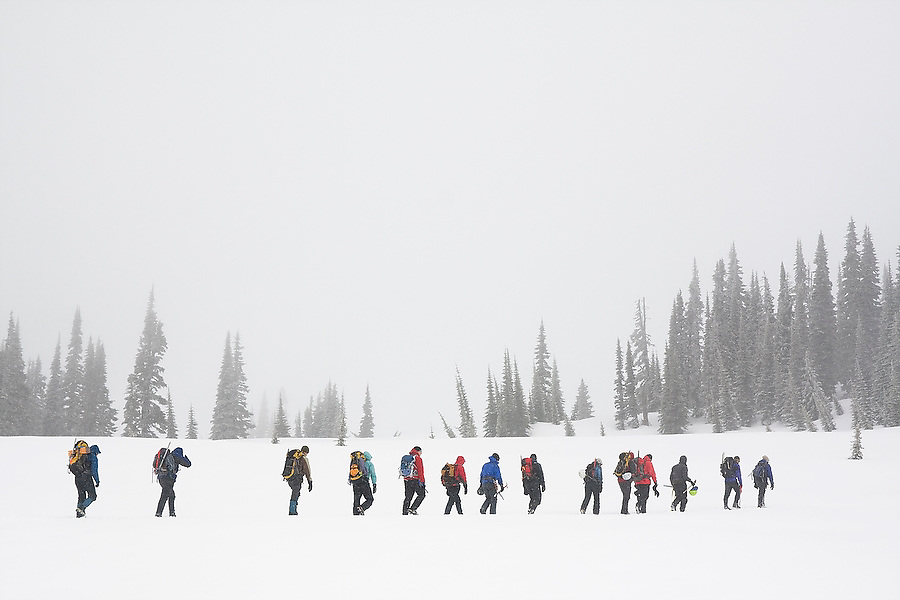 """Members of the University of Washington Climbing Club attend """"Snow School"""" at Paradise in Mount Rainier National Park, Washington. At the annual club event, members practice essential skills like glacier crevasse rescue and self arrest."""