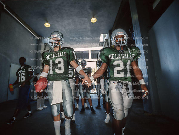BERKELEY, CA -  OCTOBER 12:  Britt Cecil #13 and Maurice Jones-Drew #21 of the #1 ranked high school football team from De La Salle High of Concord, California enter the stadium before playing the #2 ranked team from Long Beach Poly High School at a showdown on October 12, 2002 in Memorial Stadium at the University of California at Berkeley, California.  De La Salle won by a final score of 28-7, their 130th straight victory.   (Photo by David Madison/Getty Images) *** Local Caption *** Britt Cecil;Maurice Jones-Drew