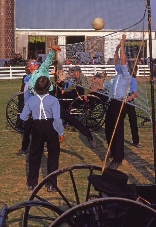 Amish boys play volleyball at youth social, Lancaster County, PA