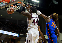 Texas A&M forward Robert Williams (44) dunks the ball as Florida guard Deaundrae Ballard (24) defends during the first half of an NCAA college basketball game Tuesday, Jan. 2, 2018, in College Station, Texas. (AP Photo/Sam Craft)